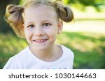excited face of pretty small... | Shutterstock . vector #1030144663