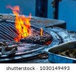 preparing cargols a la llauna ...   Shutterstock . vector #1030149493