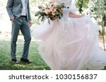 the bride and groom in the... | Shutterstock . vector #1030156837