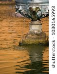Small photo of Seville, Andalusia, Spain - February 7 2017 : Fountain in the grounds of the Real Alcazar royal palace in Seville
