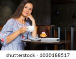 woman drink coffee while...   Shutterstock . vector #1030188517