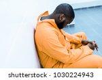 sad african american prisoner... | Shutterstock . vector #1030224943
