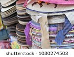 stacks of colorful cloth caps... | Shutterstock . vector #1030274503