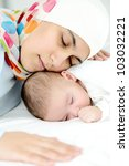 Beautiful muslim woman sleeping with her baby - stock photo