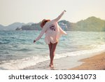 a young girl in a pale pink... | Shutterstock . vector #1030341073