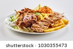 traditional greek mixed grill... | Shutterstock . vector #1030355473