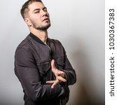 handsome man pose in studio.   Shutterstock . vector #1030367383
