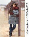 beautiful woman in grey coat...   Shutterstock . vector #1030414297