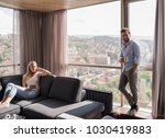 young couple relaxing at  home... | Shutterstock . vector #1030419883
