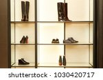 bright large luxury shoe store... | Shutterstock . vector #1030420717