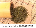 handful of green tea leaves on... | Shutterstock . vector #1030429057
