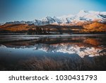 mirror surface of the lake in... | Shutterstock . vector #1030431793