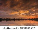 sunrise on the lake. comana... | Shutterstock . vector #1030441537