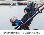 Baby Sitting In A Pram  Buggy...