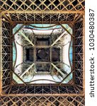 Small photo of A view looking directly up at the incredible architecture and design work through the centre of the Eiffel Tower in France.