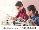 children creating robots at... | Shutterstock . vector #1030501423