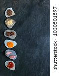 colorful spices on pebbles in a ... | Shutterstock . vector #1030501597