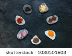 mixed spices arranged in a... | Shutterstock . vector #1030501603