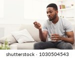serious african american man... | Shutterstock . vector #1030504543