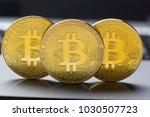 golden bitcoins on us dollars.... | Shutterstock . vector #1030507723