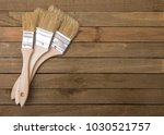 paint brushes on a wooden table | Shutterstock . vector #1030521757