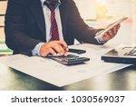 a businessman analyzing... | Shutterstock . vector #1030569037