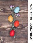 easter eggs on wooden background | Shutterstock . vector #1030574347