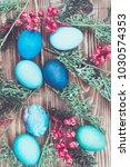 easter eggs on wooden background | Shutterstock . vector #1030574353