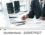 businessman using computer to...   Shutterstock . vector #1030579327