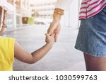 Small photo of selective focus Hand of parent and child in the outdoor .Mother holding hands little girl