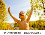 little cute real boy among tree ... | Shutterstock . vector #1030606063