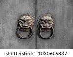 on the red door of the beast... | Shutterstock . vector #1030606837