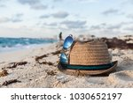 beach accessories on the sandy... | Shutterstock . vector #1030652197