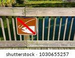 no fishing sign on wooden dock... | Shutterstock . vector #1030655257