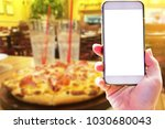 hand holding smart phone with... | Shutterstock . vector #1030680043