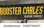 black sign saying  booster... | Shutterstock . vector #1030744447