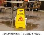 caution wet floor warning sign | Shutterstock . vector #1030757527