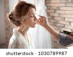 makeup artist preparing bride... | Shutterstock . vector #1030789987