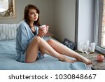 a young pretty girl in a blue... | Shutterstock . vector #1030848667