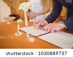 groom signing wedding document... | Shutterstock . vector #1030889737