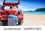 red summer car on beach with... | Shutterstock . vector #1030937407