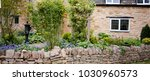 a traditional english cotswold... | Shutterstock . vector #1030960573