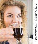positive woman holding black... | Shutterstock . vector #1030966627