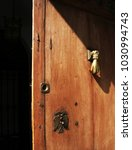 brass hand knocker | Shutterstock . vector #1030994743