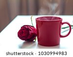 red mug with hot drink and rose ... | Shutterstock . vector #1030994983