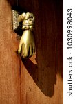 golden hand door knocker | Shutterstock . vector #1030998043