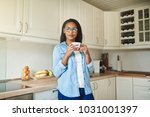 young african woman thinking... | Shutterstock . vector #1031001397