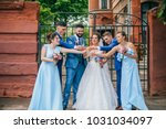beautiful newlyweds with their... | Shutterstock . vector #1031034097