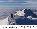 climbing on mountain in winter. ... | Shutterstock . vector #1031102113