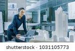 female architectural designer... | Shutterstock . vector #1031105773
